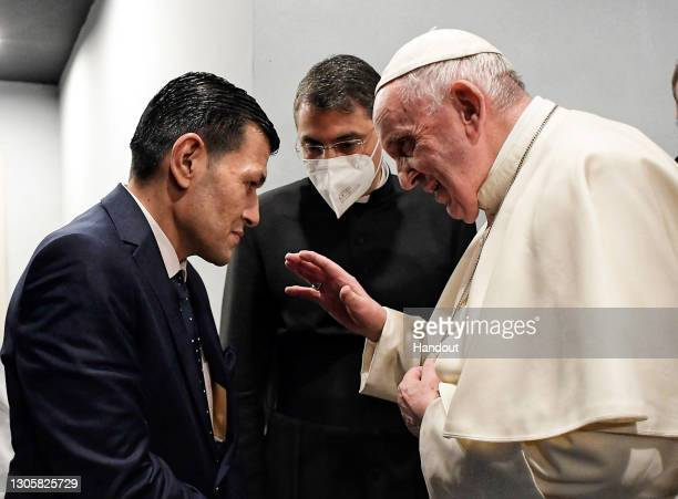 In this photograph provided by Vatican Media, Pope Francis meets Abdullah Kurdi at the end of a mass at Erbil's Franso Hariri Stadium, on March 07,...