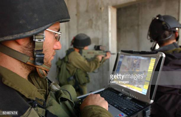 In this photograph supplied by the Israeli Defense Forces infantry soldiers from the Givati brigade are put through their paces with new hightech...