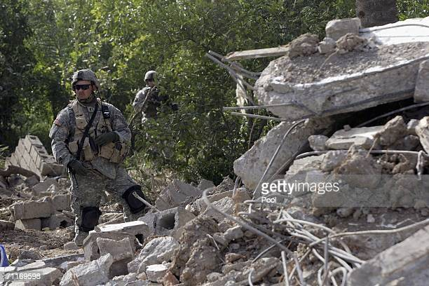 In this photograph taken during a US army media trip a soldier from the United States Army 4th Infantry Division stands guard scene of the recent air...