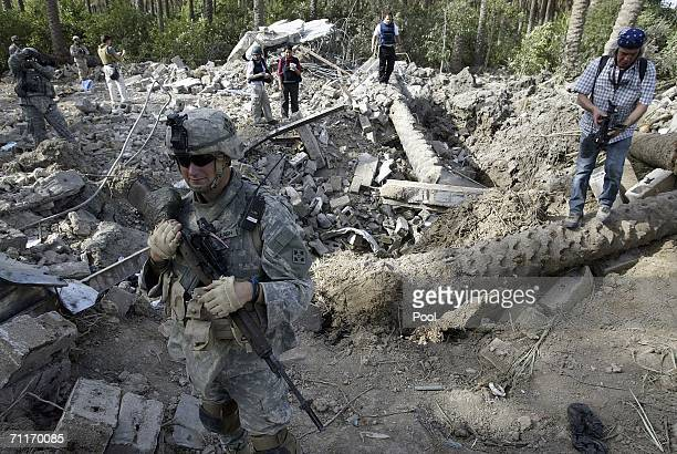 In this photograph taken during a US army media trip a United States Army 4th Infantry Division soldier keeps guard while reporters visit the scene...