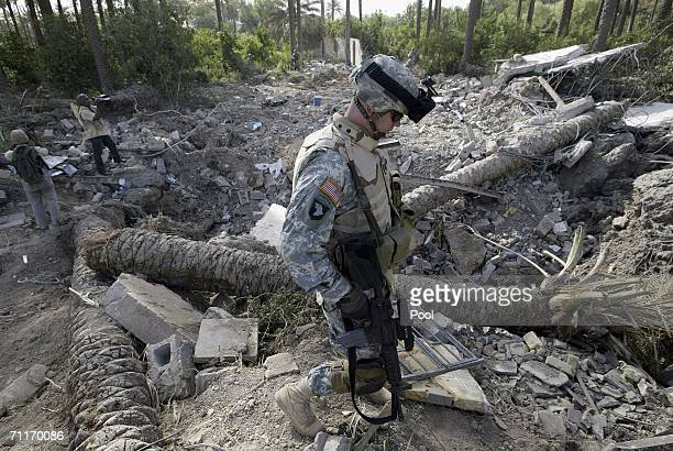 In this photograph taken during a US army media trip a United States Army 4th Infantry Division soldier walks past the a crater at the scene of the...