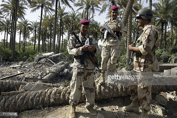 In this photograph taken during a US army media trip Iraqi Army guard the scene of the recent air strike against militant leader Abu Musab alZarqawi...