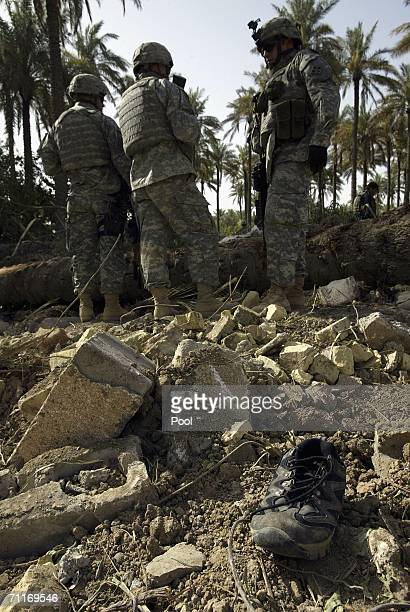 In this photograph taken during a US army media trip soldiers from the United States Army 4th Infantry Division stand guard at the scene of the...