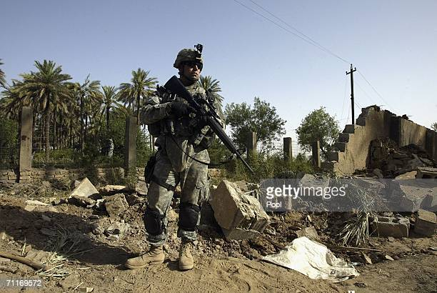 In this photograph taken during a US army media trip soldiers from the United States Army 4th Infantry Division stand guard scene of the recent air...