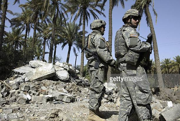 In this photograph taken during a US army media trip United States Army 4th Infantry Division soldiers guard the scene of the recent air strike...