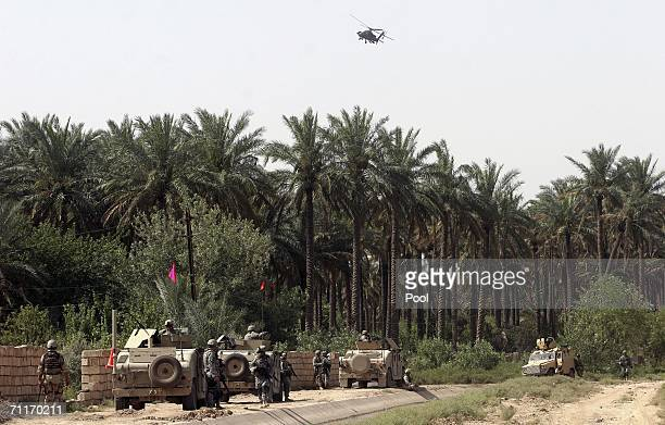 In this photograph taken during a US army media trip United States Army 4th Infantry Division soldiers and Iraqi Army guard the scene of the recent...