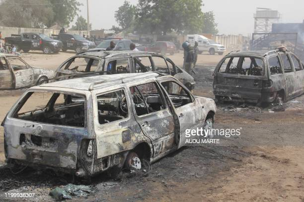 In this photograph taken in Auno on February 10 cars burnt down by suspected members of the Islamic State West Africa Province during an attack on...