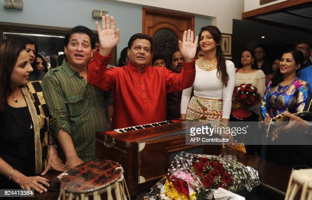 In this photograph taken July 29 2017 Indian Ghazal and Bhajan singer Anup Jalota performs with singers during the 64th birthday celebration of...