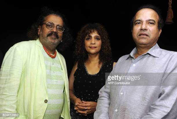 In this photograph taken July 29 2017 Indian singers Hariharan Penaz Masani and Suresh Wadkar pose for a picture during the 64th birthday celebration...