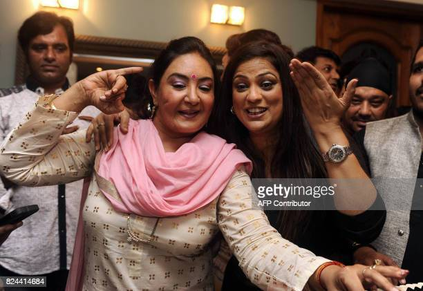 In this photograph taken July 29 2017 Indian singers Jaspinder Narula and Richa Sharma perform during the 64th birthday celebration of Ghazal and...