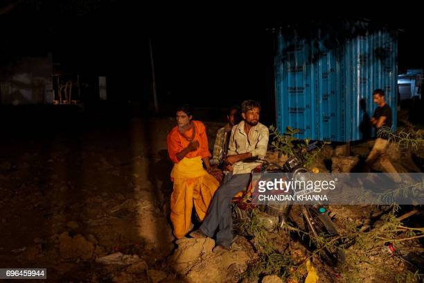 In this photograph taken June 15 Indian artists take break from the performance of 'Ramleela' play in Jaitaran some 80 kms north of Jodhpur in the...