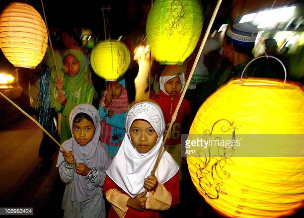 In this photograph taken late September 9 2010 Indonesian Muslim children parade with colorful lighted paper lanterns in the streets of Malang in...