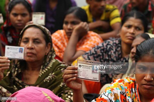 In this photograph taken on 19th May, 2013; Relatives of rana plaza victims. Bangladeshi woman reacts after identifying the body of her husband...