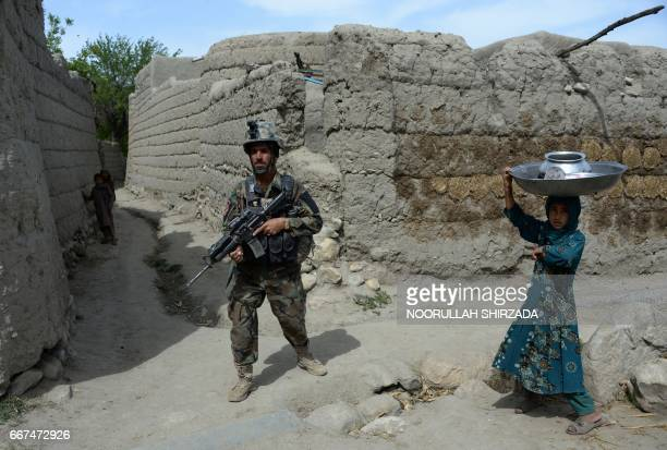 TOPSHOT In this photograph taken on April 11 Afghan security forces patrol during an ongoing an operation against Islamic State militants in the...