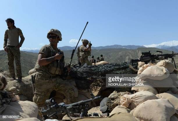 In this photograph taken on April 11 US soldiers take up positions during an ongoing an operation against Islamic State militants in the Achin...