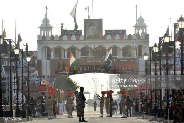In this photograph taken on April 15 Indian Border Security Force personnel and Pakistani Rangers take part in the Beating Retreat ceremony at the...