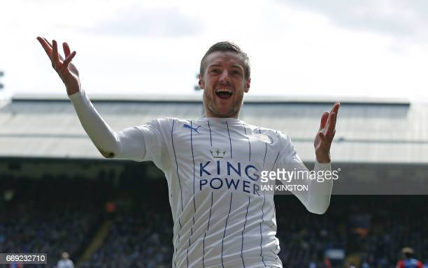 In this photograph taken on April 15 Leicester City's English striker Jamie Vardy celebrates scoring Leicester's second goal during the English...
