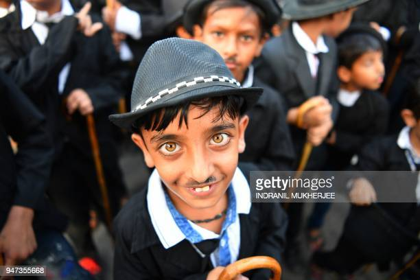 In this photograph taken on April 16 a young Charlie Chaplin impersonator poses for a picture during an event commemorating the legendary actor's...