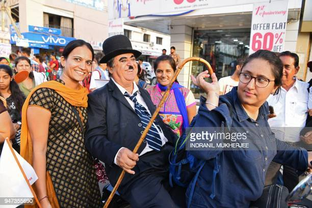 In this photograph taken on April 16 Ashok Aswani an ayurvedic doctor and founder of the Charlie Circle fan club poses for photographs with...