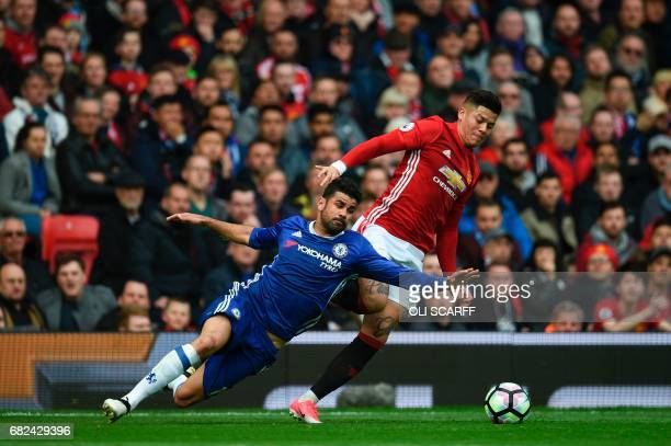 In this photograph taken on April 16 Chelsea's Brazilianborn Spanish striker Diego Costa vies with Manchester United's Argentinian defender Marcos...