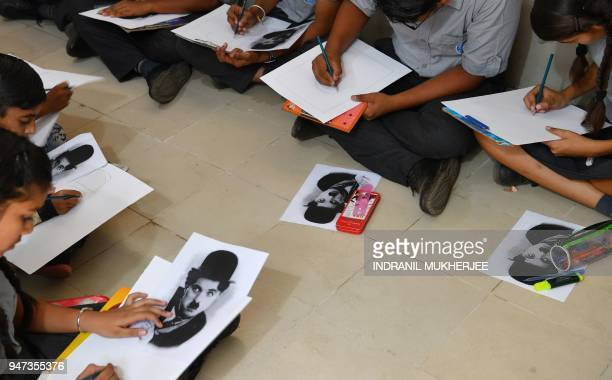 In this photograph taken on April 16 students take part in a drawing competition organised by the Charlie Circle fan club on the occasion of the...