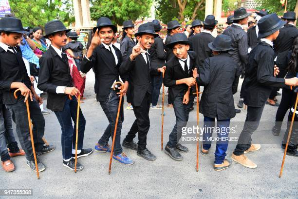 In this photograph taken on April 16 young Charlie Chaplin impersonators pose for a picture during an event commemorating the legendary actor's 129th...