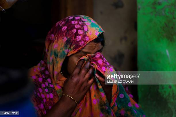 In this photograph taken on April 17, 2018 Nilufer Begum, an injured garment worker who survived the Rana Plaza disaster, reacts during an interview...