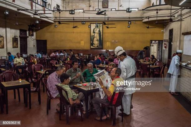 In this photograph taken on April 20 Indian customers are served inside the Indian Coffee House established in 1942 on Bankim Chatterjee street in...