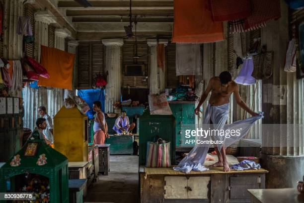 In this photograph taken on April 20 Indian Hindu priest Narendra Panda dresses at Babughat on the banks of the Hooghly River in Kolkata One of a...