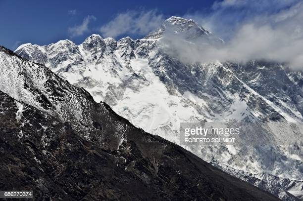 In this photograph taken on April 20 Mount Everest and the NupseLohtse massif are seen from the village of Tembuche in the Kumbh region of...