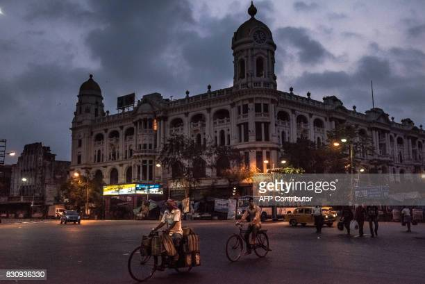 In this photograph taken on April 21 Indian commuters travel along the Esplanade in Kolkata Kolkata evolved from an East India Company trading post...