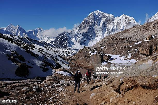 In this photograph taken on April 24 trekkers and climbers make their way up a trail leading to the village of Gorak Shep and Everest Base Camp deep...