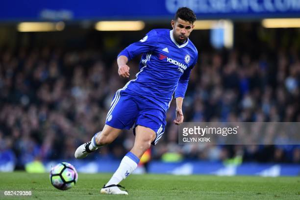 In this photograph taken on April 25 Chelsea's Brazilianborn Spanish striker Diego Costa passes the ball during the English Premier League football...