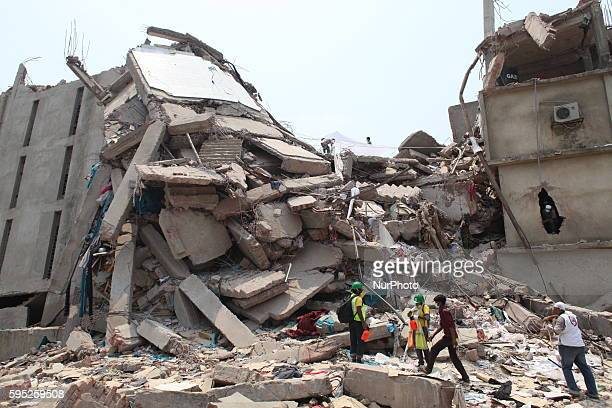 In this photograph taken on April 25 Rescue workers take part in the rescue operation on the top of the damaged building at Savar Several thousand...