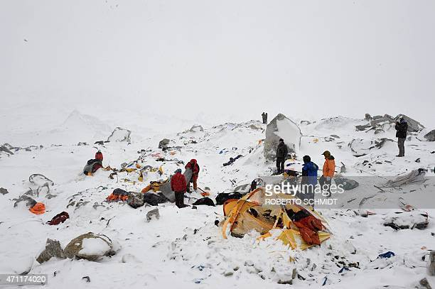 In this photograph taken on April 25 rescuers look for survivors after an avalanche that flattened parts of Everest Base Camp Rescuers in Nepal are...