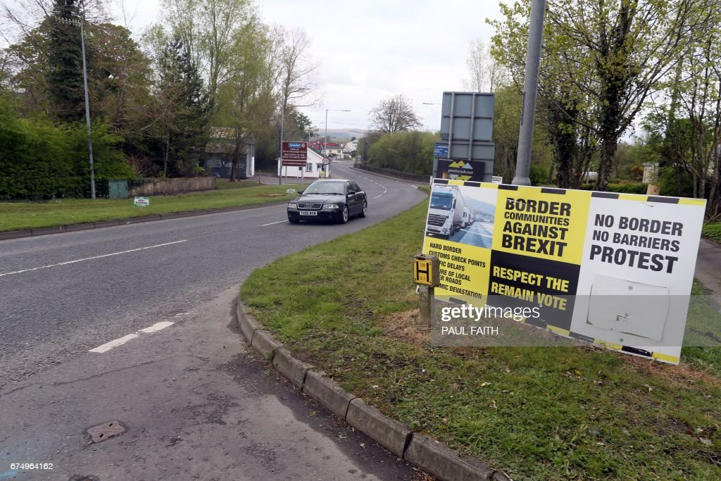 In this photograph taken on April 26, 2017, Brexit posters are pictured at the border crossing at Muff in Co Donegal near Lough Foyle, on the border with Northern Ireland and Donegal in the Republic of Ireland. For many on the oyster-rich shores of the River Foyle estuary on the northern tip of Ireland, Britain's departure from the European Union cannot come soon enough. The hope is that Brexit will solve a decades-old sovereignty dispute over the waterway between British-ruled Northern Ireland and the Republic of Ireland. FAITH