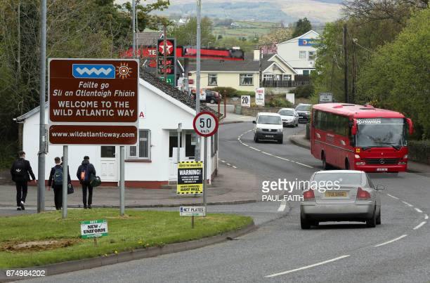 In this photograph taken on April 26 Brexit posters are pictured at the border crossing at Muff in Co Donegal near Lough Foyle on the border with...