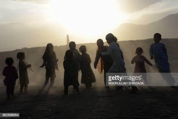 In this photograph taken on April 28 Afghan children play on the outskirts of Jalalabad.