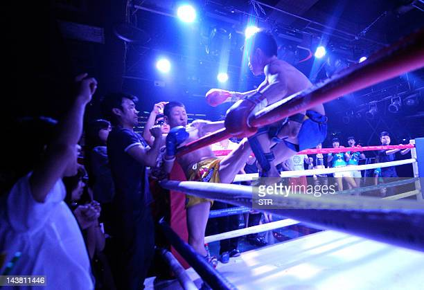 In this photograph taken on April 29 two Chinese Muay Thai enthusiasts fight during a threeround bout at a nightclub turned fightclub in Chongqing...
