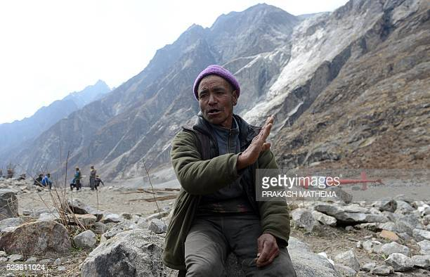 In this photograph taken on April 7 Nepalese yak herder Nurpu Tamang talks during an interview with AFP in Langtang valley in Nepal's Rasuwa...