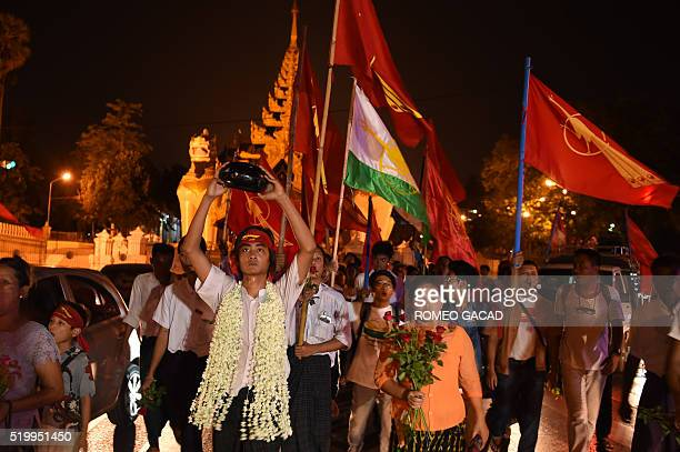 In this photograph taken on April 8 freed students and supporters march from Shwedagon pagoda to a memorial hall upon their arrival in Yangon. A...