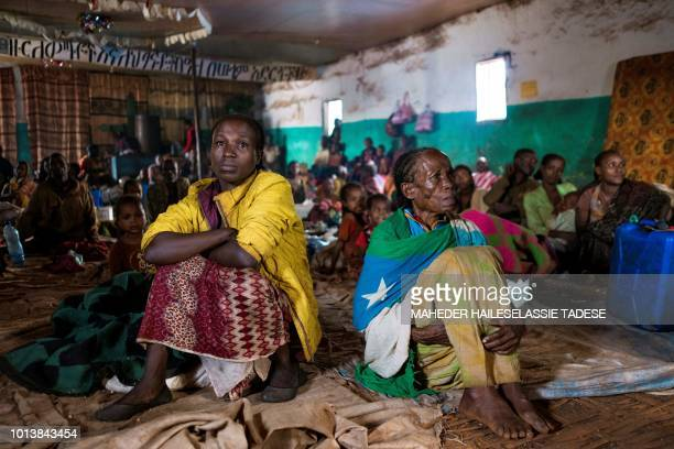 In this photograph taken on August 1 displaced Gedeo women Birtukan Chuchu and Mariam Shunki sit in a church at Kercha site West Guji in Ethiopia...