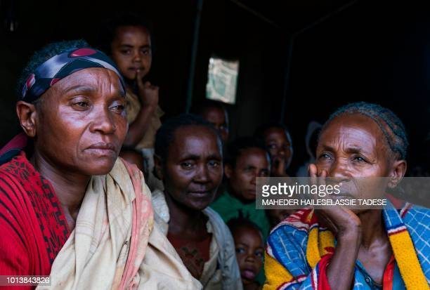 In this photograph taken on August 1 displaced Gedeo women Bogaleche Besheri and Ayeleche Fulasa both mothers of four children sit in a temporary...