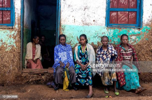 In this photograph taken on August 1 displaced Gedeo women sit at Kercha site West Guji in Ethiopia Ethiopia's Prime Minister Abiy Ahmed's aggressive...