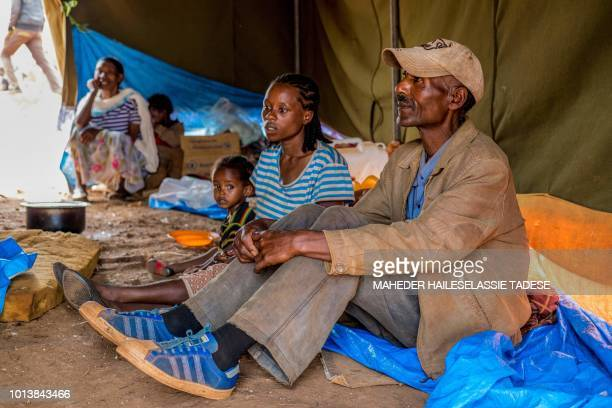 In this photograph taken on August 1 Menegesha Gobena father of six sits in a shelter for displaced Gedeos in Dilla in the Gedeb area of Ethiopia...