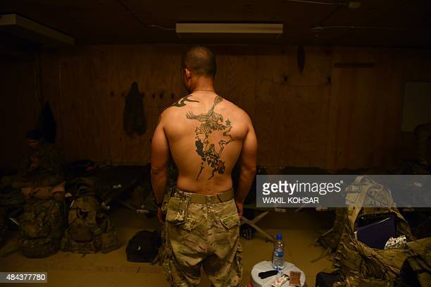 In this photograph taken on August 12 a US army soldier poses for a photograph at coalition force Forward Operating Base Connelly in the Khogyani...