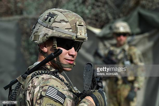 In this photograph taken on August 12 a US army soldier stands guard at an Afghan National Army base in the Khogyani district in the eastern province...