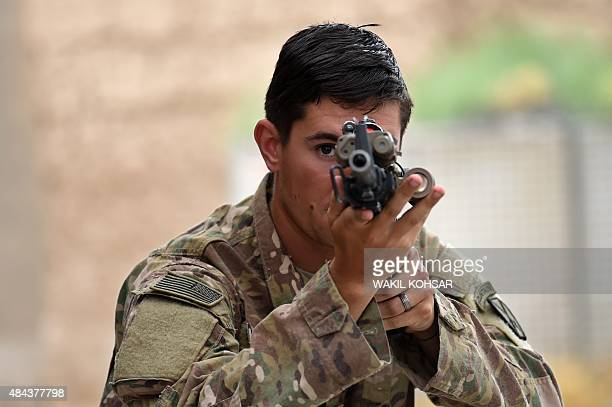 In this photograph taken on August 12 a US army soldier takes aim during a military exercise at coalition force Forward Operating Base Connelly in...