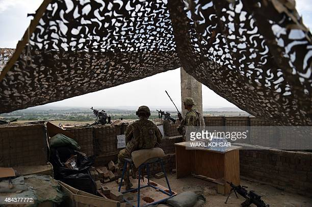 In this photograph taken on August 12 US army personnel keep watch at coalition force Forward Operating Base Connelly in the Khogyani district in the...