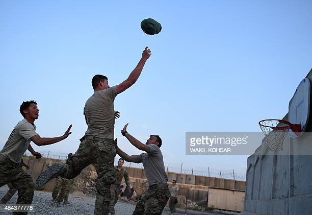 In this photograph taken on August 12 US army soldiers play basketball at coalition force Forward Operating Base Connelly in the Khogyani district in...